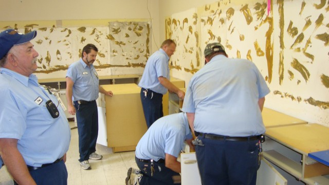 The destruction team breaking down the old room